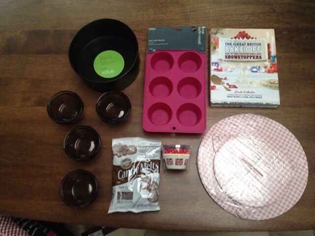A range of baking items including Cake tin, muffin tin & cases, cupcake stand, glass ramekins & more