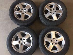 "2005 Dodge caravan 16"" alloy rims with tires 215 65R16"