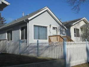 2 bedroom centrally located house with 2 car garage