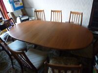 Teak extendable dining table with 8 chairs