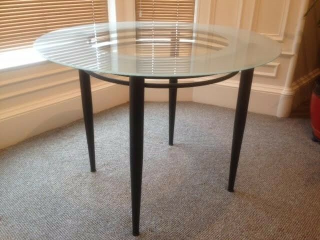 Glass top circular table. {No chairs, sorry}
