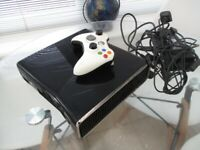 Xbox 360s black,1 controller with 4 games