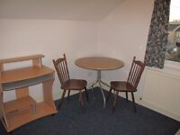 Clean comfortable studio flat on Chesterton Road nr DeFreville Ave . Rent inc gas central heating .