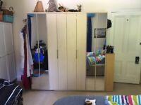 8 Door wardrobe. £100.