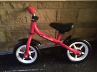 Brand new Avigo childrens balance bike in red