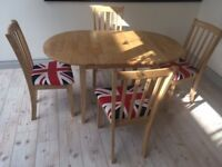 Oval Extending Dining table in light oak and 4 upholstered chairs with union jack covers, almost new