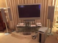 SONY 42 inch flat screen TV with stand and DVD surround speaker system