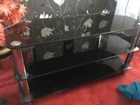 Glass tv stand , black colour good condition from smoke and pet free house
