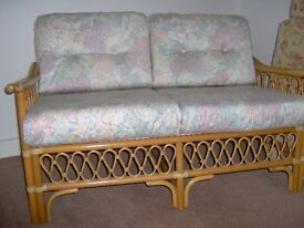 cane and wicker two seater sofa complete with cushions