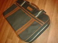 Large green courier travel bag.