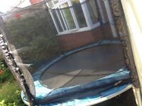 8ft circular trampoline with net FREE to collect. Great for the garden and young children