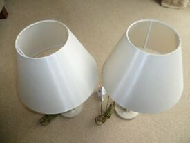 TWO MATCHING BEDSIDE LAMPS WITH CREAM COLOURED SHADES