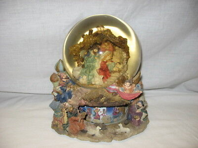 (Nativity Scene Christmas Snow Globe Plays Silent Night has Rotating Bottom)