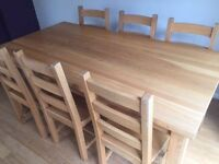 Solid oak table and chairs (delivery available)ok