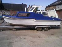 20ft Fibreglass boat with cabin, 30HP Tohatsu outboard and trailer