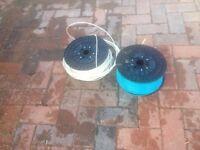 2x large rolls of semi rigid plastic cord