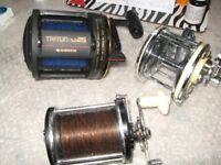 Triton TLD25 boat reel with line plus 2 other reels but dont know their make