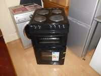 NEARLY NEW SWAN SX2011B, 50 CM WIDE, FREESTANDING TWIN CAVITY ELECTRIC COOKER IN BLACK RRP £289