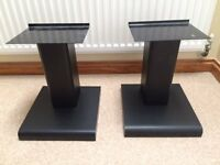 Two solid speaker stands in black