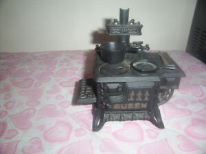 vintage miniature cast iron stove.