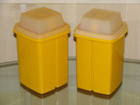 Yellow Tupperware pickle containers