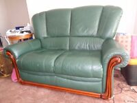Lovely comfortable racing green two seater settee