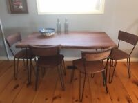 Solid wood dining table with 4 chairs.