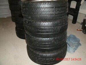 4 Eagle Tires & Pontiac white alloy rims from Grandam GT