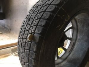 FULL SET OF SNOW TIRES....235/60 R18..ALLOY RIMS & BOLTS...