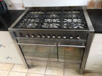 Free standing SMEG stainless steel range cooker with 5 gas hobs and two ovens