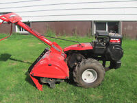 Rear tine Tiller 5 hp like new condition.