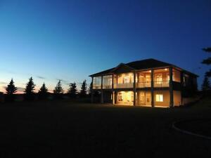 EXECUTIVE CUSTOM HOME WITH OVER 6000 SQ FT OF LIVING SPACE