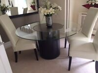 ROUND DINING FOR SALE, black base woth glass top and with lazy Susan in the
