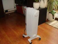 Electric oil radiator on wheels