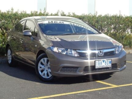 2013 Honda Civic 9th Gen Ser II MY13 VTi Grey 5 Speed Sports Automatic Sedan