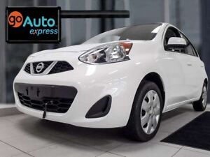 2016 Nissan Micra SV with manual transmission. It's a little jel