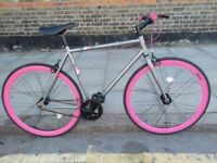 Pink and grey single speed bike/Fixie bike