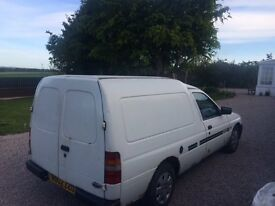 White Ford Escort Van 2002 deseil with numerous spares ususal rust for age very reliable