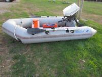 8ft. Nissan rubber boat with motor