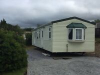 Willerby Colwyn. Special dealer model on a great pitch. Fantastic views of countryside and mountains