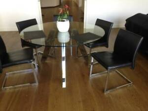 Glass dining table ..round and chairs
