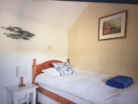 Wooden 3ft single bed with good mattress and extra pullout bed