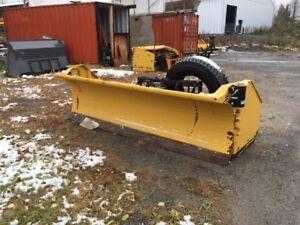 Backhoe plow