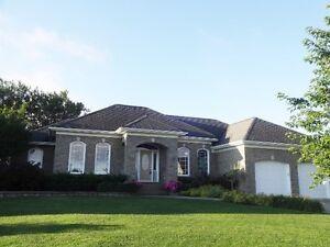 Executive home on Royal Oaks golf course.
