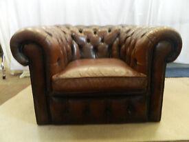 large vintage button-back leather armchair