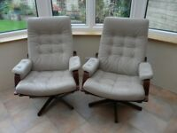 Two Reclining /swivel leather chairs