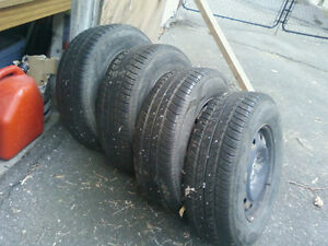 4 TIRES & RIMS SELL or TRADE FOR WINTER TIRES 235/16