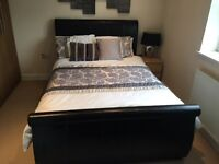 Black leather double bed.