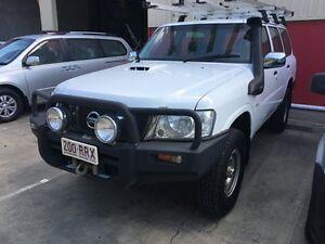 2010 Nissan Patrol GU 7 MY10 DX White 5 Speed Manual Wagon Murarrie Brisbane South East Preview