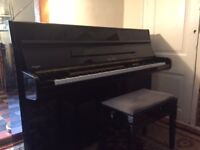NOW SOLD Geyer black upright overstrung piano & stool, good tone, compact size. Buyer collects.